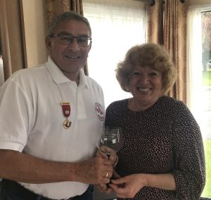 The Immediate Past Chairman, Gordon Barlow, presenting the retirering Treasurer, Ann Smith, with her retirement gift of an engraved Gin Glass.